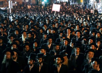 Ultra Orthodox Jewish men attend a rally against the coronavirus restrictions and enforcement, in Jerusalem's Mea Shearim neighborhood, February 9, 2021. Photo by Noam Revkin Fenton/Flash90     *** Local Caption *** ????? ????? ????? ??? ?????? ????? ??????? ????? ?????