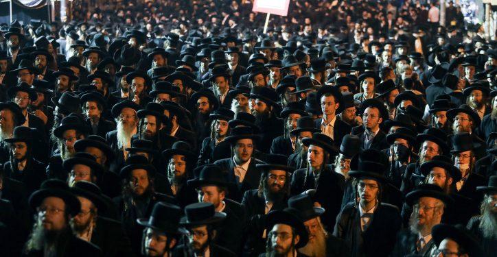 Ultra Orthodox Jewish men attend a rally against the coronavirus restrictions and enforcement, in Jerusalem's Mea Shearim neighborhood, February 9, 2021. Photo by Noam Revkin Fenton/Flash90     *** Local Caption *** ????? ????? ????? ??? ?????? ????? ??????? ????? ?????