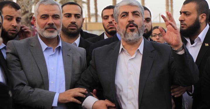 Hamas leader in exile Khaled Meshaal greets members of the Palestinian family of Kamal al-Nayrab, the killed leader of the Popular Resistance Committees in Rafah, southern Gaza Strip on December 10, 2012. Exiled Hamas chief Khaled Meshaal left Gaza after a historic first visit to the tiny Palestinian enclave.Photo by Abed Rahim Khatib / Flash 90 *** Local Caption *** ???? ??? ???? ???? ??????? ???????? ??????? ???????