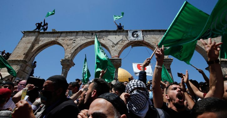 People hold Hamas flags as Palestinians gather after performing the last Friday of Ramadan to protest over the possible eviction of several Palestinian families from homes on land claimed by Jewish settlers in the East Jerusalem neighborhood of Sheikh Jarrah, May 7, 2021. Photo by Jamal Awad/Flash90 *** Local Caption *** ?????? ????? ????? ????? ??????? ??? ???? ????