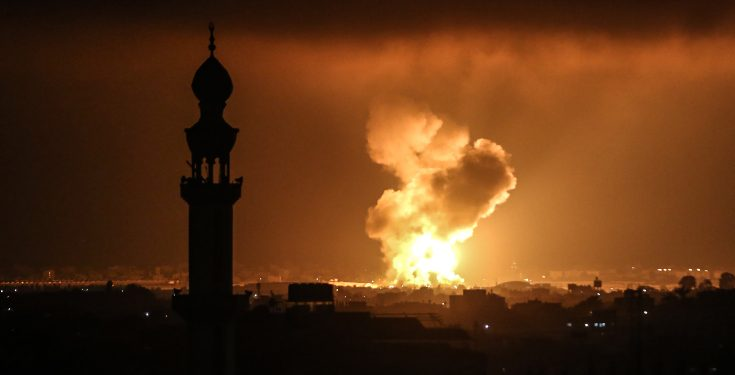 Smoke and flames rise after an Israeli airstrike in a site of the Izz al-Din al-Qassam Brigades, the armed wing of Hamas, in the west of Khan Yunis, in the southern Gaza Strip, on May 11, 2021. Photo by Abed Rahim Khatib/Flash90  *** Local Caption *** ??? ????? ??? ???????? ????? ????? ??????? ??? ???? ????