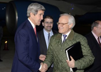 US Secretary of State John Kerry (L) with US Special Envoy for Israeli-Palestinian Negotiations Martin Indyk while returning from a day trip to Jordan and Saudi Arabia at Ben Gurion International Airport on January 5, 2014 Outside Tel Aviv. Photo by Matty Stern/US Embassy Tel Aviv/Flash90 *** Local Caption *** ??? ??? ??? ?'?? ??? ?? ?????? ??? ????? ????? ??????