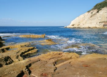 Rocks and white chalk cliff at Rosh HaNikra reserve on Mediterranean sea in Israel.