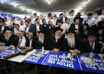 Members and supporters of the ultra orthodox party, Yehadut Hatorah (United Torah Judaism) seen at the party headquarters in Bnei Brak as the exit polls in the Israeli general elections for the 20th parliament are announced on March 17, 2015. Photo by  Yaakov Naumi/FLASH90 *** Local Caption *** ?????? ???? ???? ??? ???  Bnei Brak  ????? ????? ??? ??????