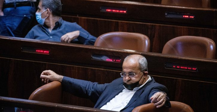 """MK Ahmad Tibi seen during a discussion on a law regarding workleave without payment, during a plenum session in the assembly hall of the Israeli parliament, in Jerusalem, on July 01, 2021. Photo by Yonatan Sindel/Flash90 *** Local Caption *** ????? ???? ??? ???? ??""""? ???? ????"""