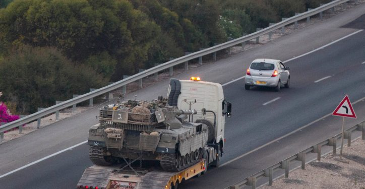 A truck carrying an IDF tank to a gathering point seen in Southern Israel, as the military prepares for a wider operation on Gaza, on the second day of Operation Protective Edge, July 9, 2014. Photo by Yonatan Sindel/Flash90 *** Local Caption *** ????? ??? ???? ????? ???? ??? ????