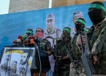 Spokesman of al-Qassam Brigades, the military wing of Hamas movement, Abu Obeida speaks during an anti-Israel military parade of the al-Qassam Brigades, the armed wing of the Hamas movement, to mark the second anniversary of the killing of Hamas's military commanders Mohammed Abu Shamala and Raed al-Attar on August 21, 2016 in Rafah in the southern Gaza Strip. Photo by Abed Rahim Khatib/Flash90  *** Local Caption *** ???? ?????? ???? ?????? ???? ??????? ????????? ??? ????? ???? ?????? ?????? ???