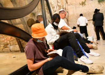 Jewish men pray at the Western Wall on the eve of Tisha B'Av in the Old City of Jerusalem, on July 29, 2020. The Tisha B'Av ceremony, literally the ninth day of the month of Av in the Hebraic calendar, is the darkest day in the Jewish calendar, marking the destruction of the two temples, first by the Babylonians in 587 BC and later by the Romans in 70 AD. Photo by Mendy Hechtman/Flash90  *** Local Caption *** ????? ???? ??? ?????? ????? ??? ?? ????? ?????? ??????? ??? ???? ????? ?????
