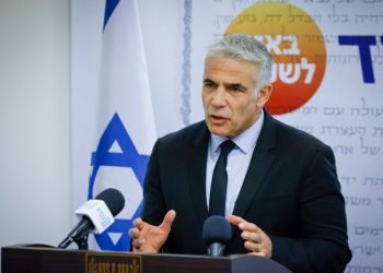 Head of the Yesh Atid party Yair Lapid speaks during a faction meeting at the Knesset, the Israeli parliament in Jerusalem, on July 5, 2021. Photo by Olivier Fitoussi/Flash90 *** Local Caption *** ???? ???? ?? ???? ???? ????