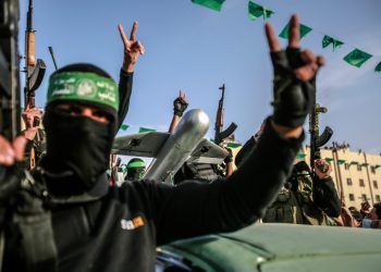 """Members of Al-Qassam Brigades, the armed wing of the Hamas movement, display a drone as they attend a rally in Beit Lahiya on May 30, 2021. Photo by Atia Mohammed/Flash90  *** Local Caption *** ???? ??????? ???????? ??????? ???? ?????? ????? ??????, ????? ?????? ?? ????? ?????, ?????? ???""""? ???? ??? ??????? ????? ???? ?????."""