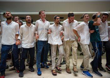 Jewish men dance during Simchat Torah celebrations at Har Hamor Yeshiva in Jerusalem on October 1, 2018. Photo by Aharon Krohn/Flash90 *** Local Caption *** ???? ???? ????? ????? ?????? ??? ???? ??? ????? ?? ??? ????? ???????